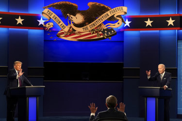 Moderator Chris Wallace of Fox News (centre) during the first presidential debate between President Donald Trump, left, and Democratic candidate Joe Biden.