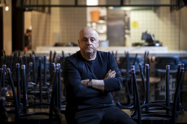 Chris Lucas, pictured here in his Melbourne CBD restaurant Chin Chin, says it won't be viable for most restaurants to reopen under the Victorian government's 10-patron cap.