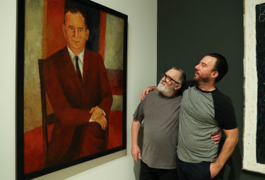 Three generations of Noffs: Wesley Noffs (centre) with a portrait of his father Ted and son Matt (right) at the Art Gallery of NSW.