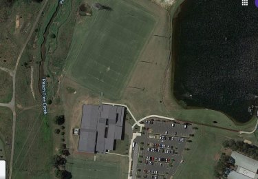 Penrith's academy (pictured on Google Maps) is situated right next to the overflowing Peach Tree Creek.