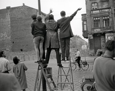 West Berliners look across the Berlin Wall to the east in 1961.