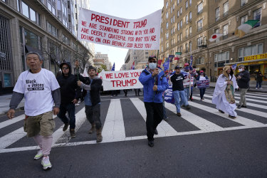 Supporters of President Donald Trump walk to Freedom Plaza on Saturday.