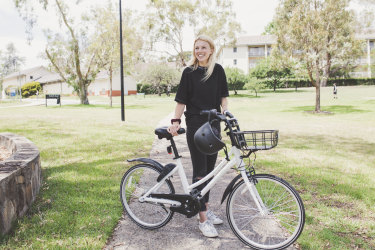 Charlotte England, pictured above, is one of thousands of Canberrans using Airbike to travel around the city.