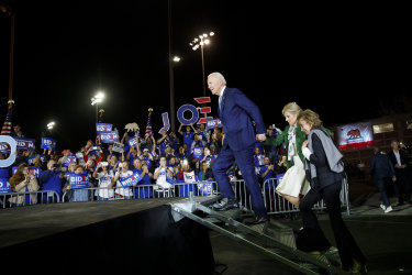 Joe Biden arrives with his wife Jill Biden, left, and sister Valerie Biden, right, to a primary night rally Los Angeles in 2020