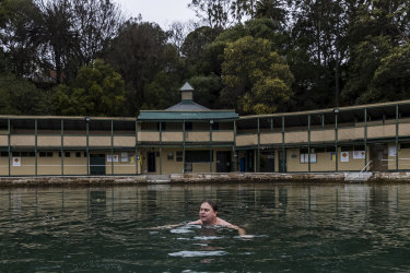 Lifeguard Darren Thorne braves the cool waters of the Dawn Fraser Baths, which require millions of dollars of repairs due, in part, to the effects of climate change, according to Inner West councillor Rochelle Porteous.