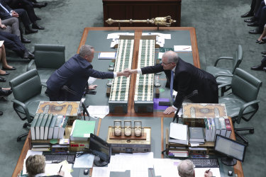 Opposition Leader Bill Shorten and Prime Minister Scott Morrison shake hands at the start of Question Time.