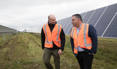 NSW Energy and Environment Minister Matt Kean (left) with John Barilaro, the Deputy Premier and Nationals leader, during a visit in August 2020 to a solar farm near Dubbo.