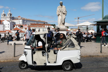 One of the hundreds of three-wheeled tuk-tuks taking tourists around Lisbon's sights.