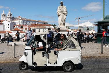 One of the hundreds of three-wheeled tuk-tuks taking tourists around Lisbon's sights.