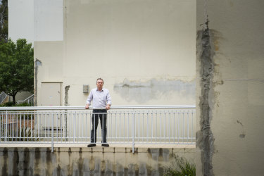 Damage alleged to have been caused by water leaks at the Elara complex. Dave Allen is pictured at the site.