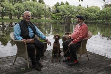 Gallery owner Tim Olsen and his father, artist John Olsen, at John's home and studio in Glenquarry, with dog Duke.