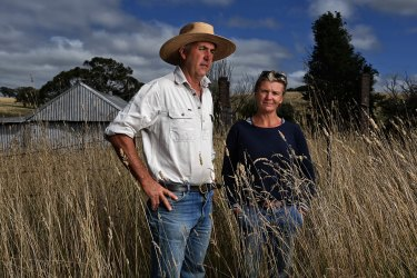 Farmers Rebecca and David Price on the site of a proposed gold mine near Blayney in central NSW. They worry the mine would leave behind a leaching tailings dam and remove thousands of hectares of farmland from production.