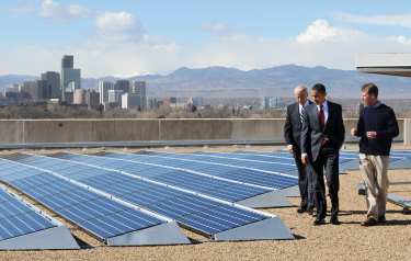 Picking up where Barack Obama left off: Joe Biden (left) visits rooftop solar panels in Denver, Colorado in 2009, when he was US Vice-President.