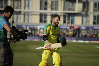 Australia's David Warner leaves the field after the Cricket World Cup match between Afghanistan.