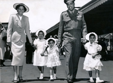 Reg Saunders with his family at Spencer Street Station after arriving back in Australia from Korea.