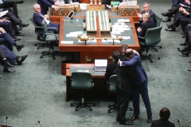 The image of Josh Frydenberg and Ed Husic embracing in Parliament was shared widely on social media.
