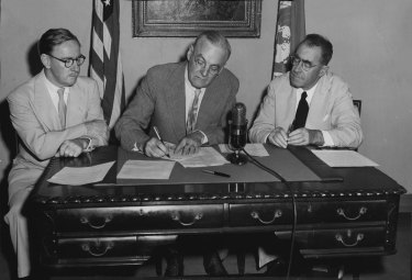 Percy Spender (left), John Foster Dulles and Sir Carl Berendsen initial the ANZUS Treaty in San Francisco in 1951.