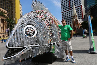 Mackay artist David Day designed a fish sculpture made from 4000 recycled cans and water bottles for the Containers for Change initiative in Queensland.