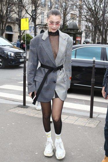 Bella Hadid wearing hot streetwear newcomer Heron Preston.