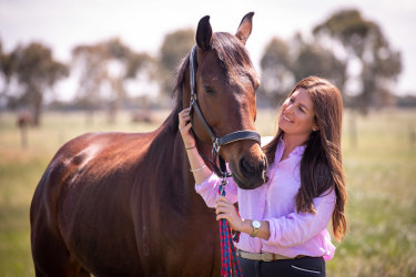 Nikki Cook, pictured with Grand Dreamer, has found new homes for about 300 ex-racehorses this year.