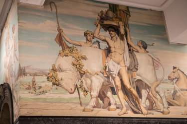The Napier Waller mural in the entrance up to the Queen's Hall.