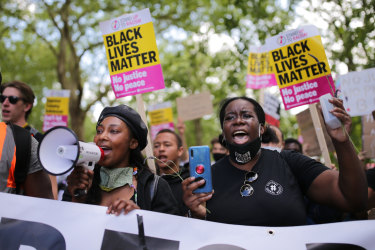 Anti-racism protesters attend a Black Lives Matter rally in London.