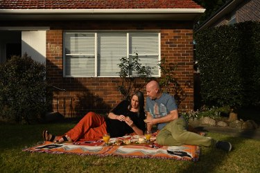 Nerida Walters and her husband Steve Welch in the front yard of their Maroubra home.