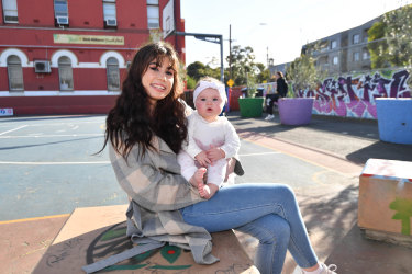Year 11 student Emily Romano and her  daughter Gia attend St Joseph's Flexible Learning Centre in North Melbourne.