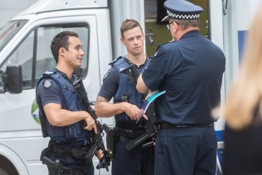 Mr Ashton speaks to officers holding long arm firearms. These are not the exact weapons Victoria Police will use. This is still be decided.