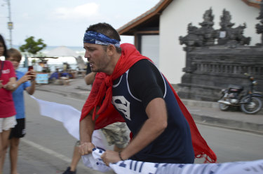 Kyron Gosse breaks through the finish line.