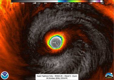 This false-colour satellite image provided by the National Oceanic and Atmospheric Administration shows the moment the eye of Super Typhoon Yutu passed over Tinian, one of three main islands in the US Commonwealth of the Northern Mariana Islands.