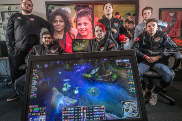 The Bombers eSports team, owned by the Essendon Bombers AFL team. Carlo La Civita (back row, second from left), says the investment has helped a lot.