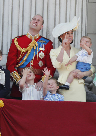 Prince William and Kate with their children.
