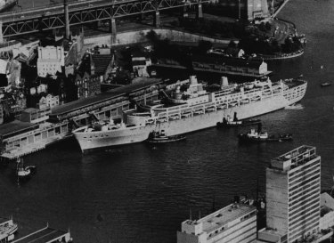 """""""This aerial picture was taken by a """"Herald"""" staff photographer yesterday as the 42,000-ton Oriana, of the P and Q orient fleet, maneuvered into her berth at the new Circular Quay terminal. December 30, 1960. """""""