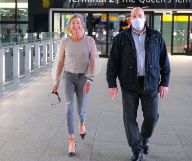 Far-right British commentator Katie Hopkins, left, at Heathrow Airport, being escorted to a Mercedes.