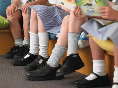 The 21-year-old is charged over taking unauthorised photos of children at WA schools.