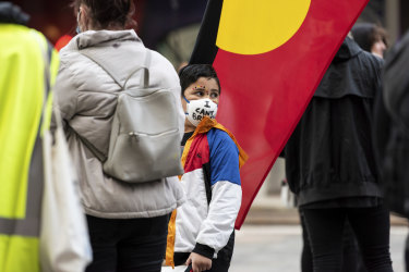 """The last words of George Floyd, """"I can't breathe"""" were written on face masks and placards."""
