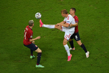 Kasper Dolberg of Denmark controls the ball whilst under pressure from Jan Boril.