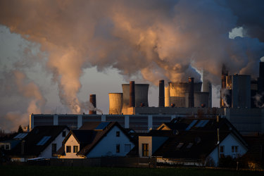 Steam rises from cooling towers at the Niederaussem coal-fired power plant in Germany. The electricity sector has low-carbon alternatives but other sectors are so far lagging.