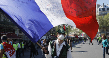 A man waves the French flag during the demonstration.