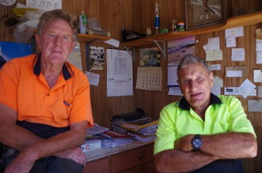 Maramingo Creek timber worker Fred Becker (right), pictured here with his brother Ron, died from a suspected heart attack after protecting his home from Tuesday's fires.