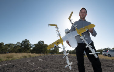 Wing chief executive James Ryan Burgess, pictured above with one of the quieter model drones.