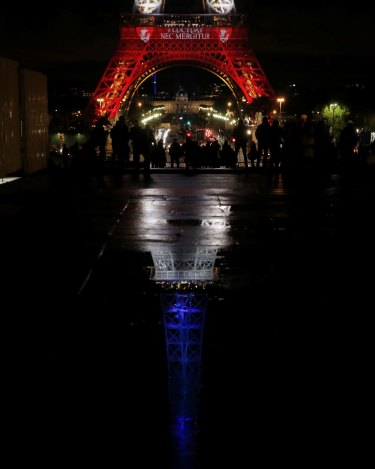 The Eiffel Tower was cast in the red white and blue of the French tricolour.