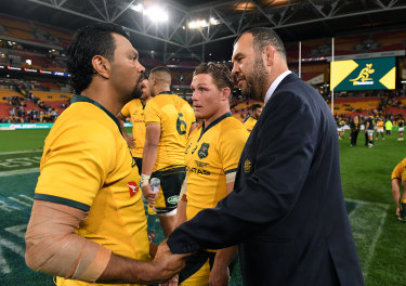 Michael Cheika congratulates Kurtley Beale following the win.