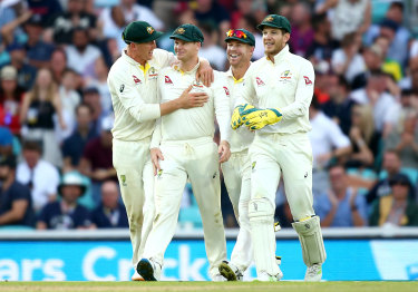 Steve Smith celebrates with his teammates after catching out Chris Woakes.