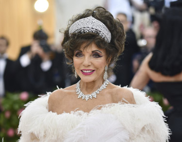 Joan Collins adding a regal touch to the Met Gala.