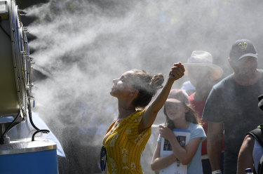 Spectators try to keep cool at a sizzling day at the Australian Open in early 2019.