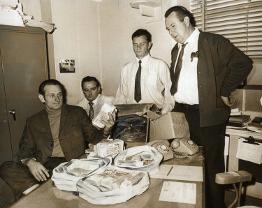 CIB officers recover more money from the Qantas bomb hoax from a shop in Annandale on 6 August 1971.