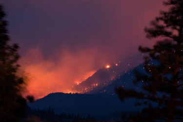 A wildfire near Lytton in Canada's British Columbia in early July. The town recorded 49.6 degrees in late June, smashing the nation's previous record temperature by a shocking five degrees.