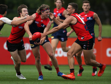 Hunt and gather: Bombers surround Melbourne's Jayden Hunt.